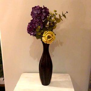 Green purple flowers in brown metal vase hydrangea
